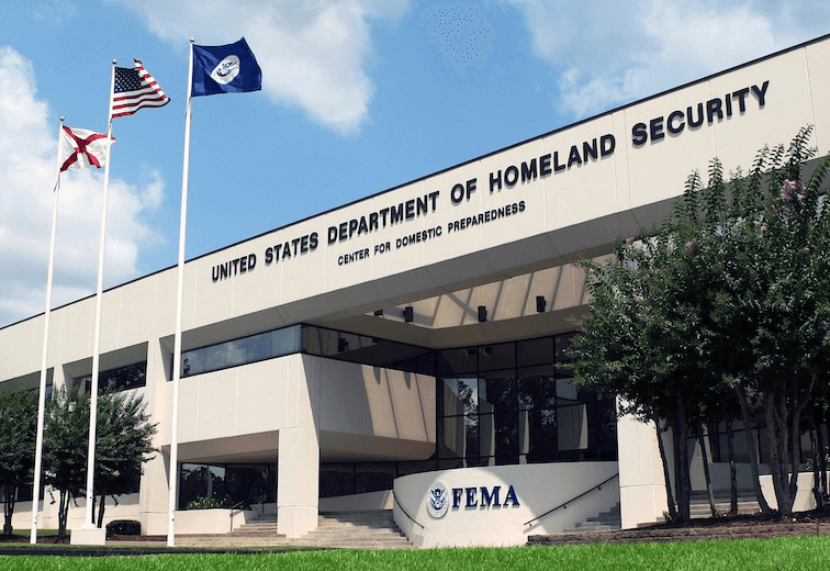 DHS building with flags