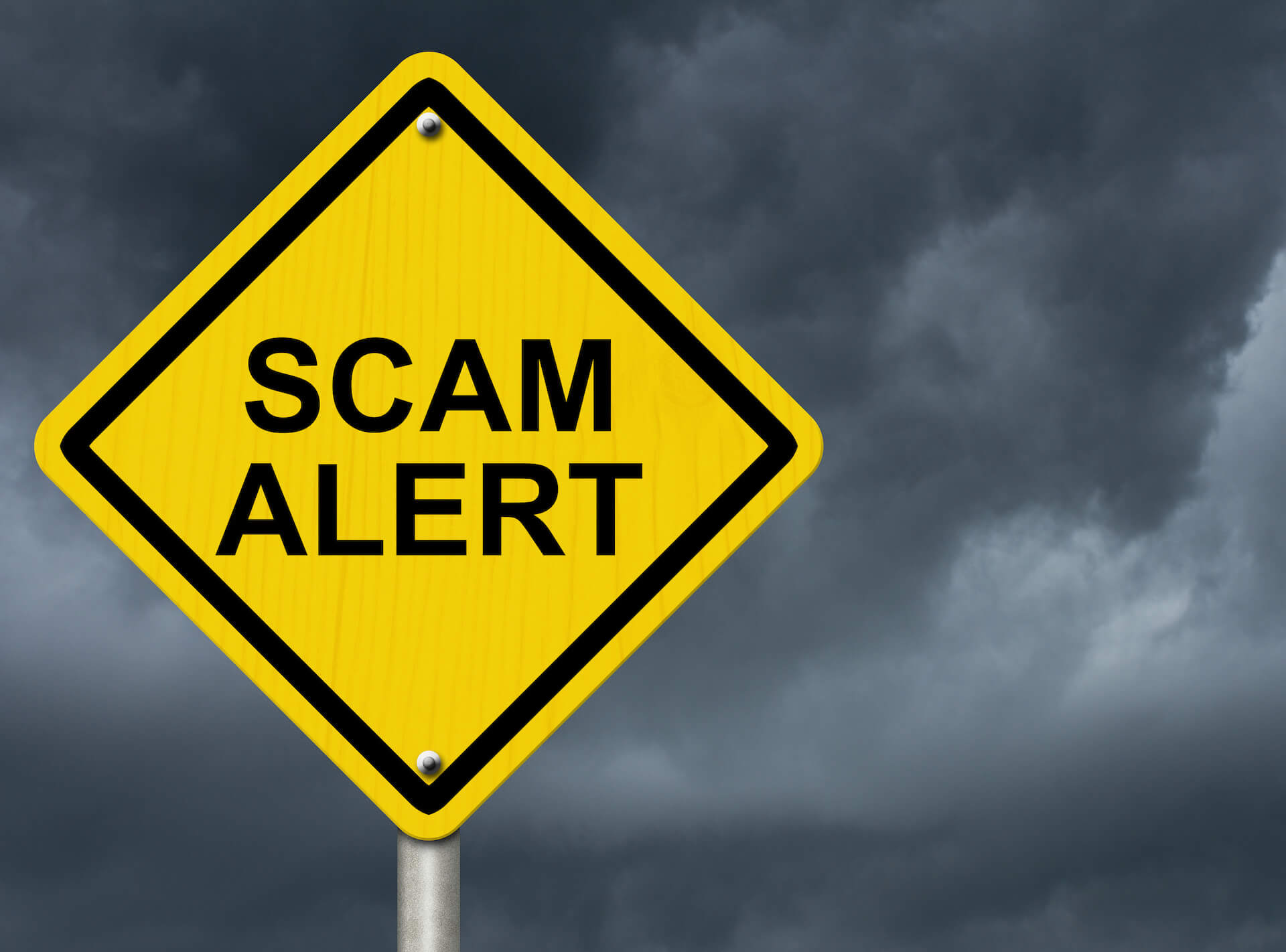 Scam Alert yelloy yield street sign rx