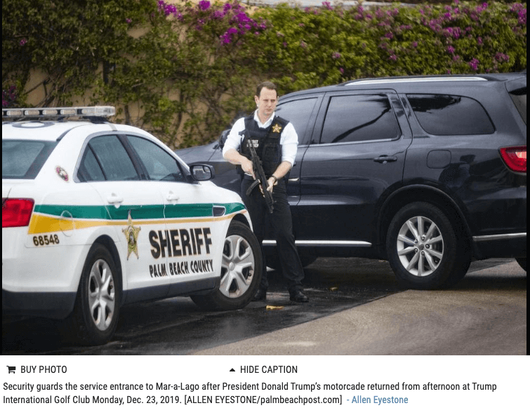 Photo of armed police and Palm Beach Sheriff's car at entrance to Mar-a-Lago.
