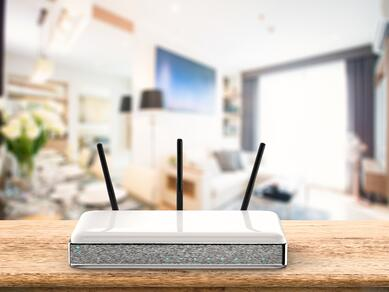 Wi-Fi router on light wood desk in living room