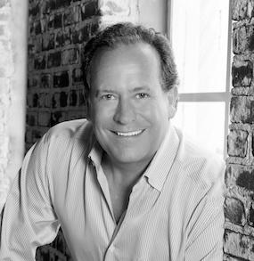black and white photo portrait of Brad Deflin