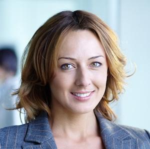 attractive woman smiling grey suit brunette
