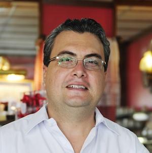 man in glasses smile white shirt