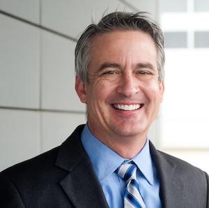 portrait man smiling in suit