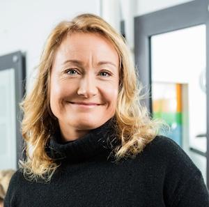portrait woman blonde in black sweater testimonial