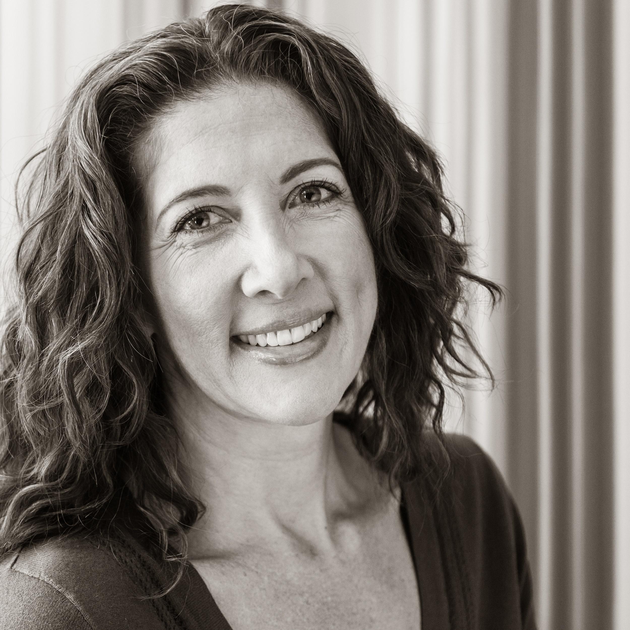 happy smiling woman dark hair white room customer review