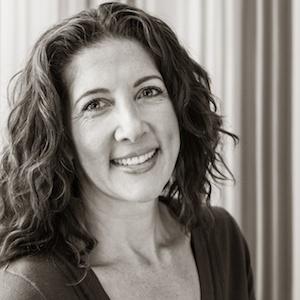 black white portrait woman smiling dark hair greying