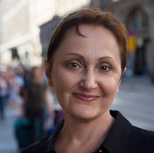 woman smiling on strret walk black dress