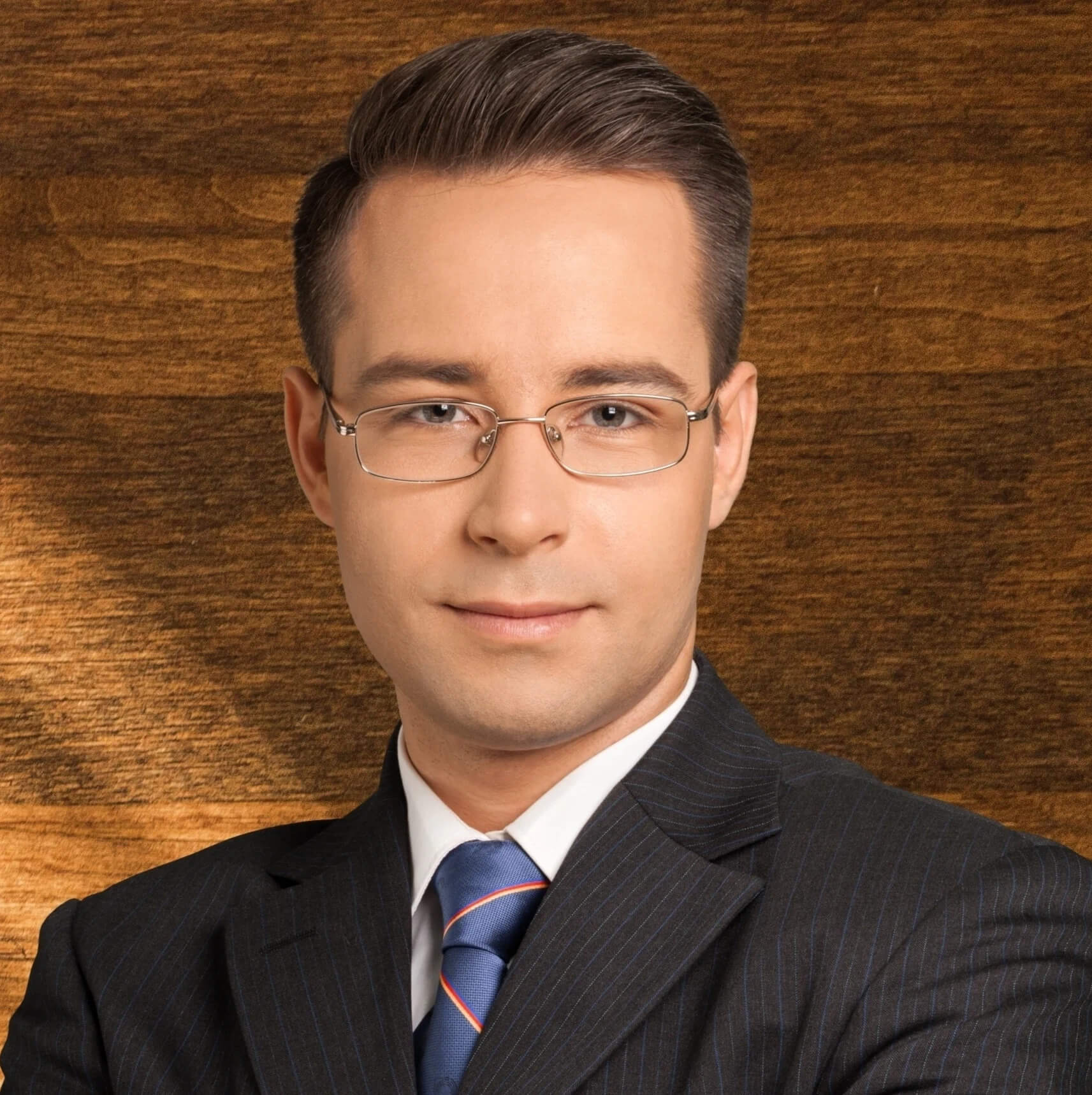 young lawyer in glasses and suit wood paneling office