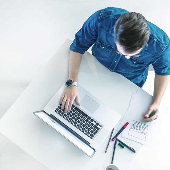 man blue shirt laptop desk using private email account