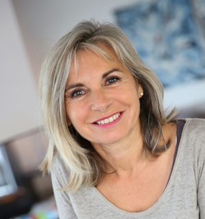 mature woman at home smiling to camera