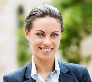 business woman in suit smiling